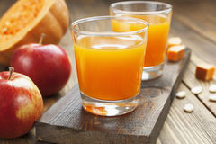 Juice of apples and pumpkins Royalty Free Stock Photography
