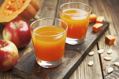 Juice of apples and pumpkins Royalty Free Stock Photos