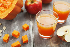 Juice of apples and pumpkins Stock Photos