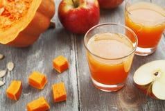 Juice of apples and pumpkins Stock Photos