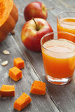 Juice of apples and pumpkins Stock Photography