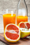 Juice of apples and red grapefruit. Stock Images