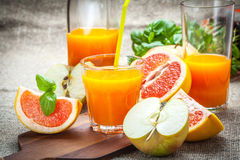Juice of apples and red grapefruit. Stock Image