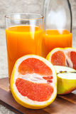 Juice of apples and red grapefruit. Stock Photography
