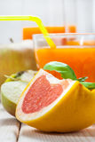Juice of apples and red grapefruit. Royalty Free Stock Image