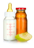 Juice, baby bottle and apple Royalty Free Stock Photos