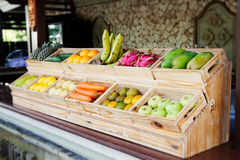 Juice Bar with assorted fresh fruits and vegetables. Tropical outdoor background Royalty Free Stock Image