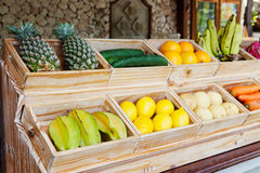 Juice Bar with assorted fresh fruits and vegetables. Tropical summer outdoor background. Stock Images