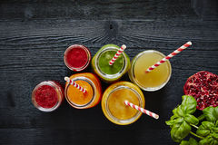 Juice bar colorful drinks with straws ready to drink Royalty Free Stock Images