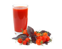 Juice, basil and cherry tomatoes Royalty Free Stock Images