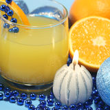 Juice, beads and candles. Royalty Free Stock Images