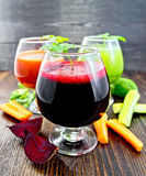 Juice beet and cucumber in wineglass on board Stock Image