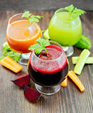 Juice beet and cucumber in wineglass on dark board Stock Image