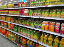 Juice And Beverages In Supermarket. Beverages and soft Drinks in China supermarket shelf Royalty Free Stock Images