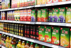 Juice And Beverages In Supermarket. Beverages and soft Drinks in China supermarket shelf Royalty Free Stock Photo