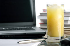Juice and books. The glass of juice and is a lot of books on a white background Royalty Free Stock Photos