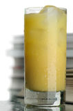 Juice and books Stock Photography