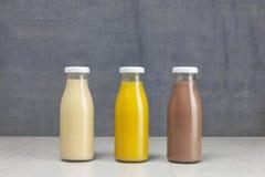 Juice Bottle Mock-Up - três garrafas Imagens de Stock