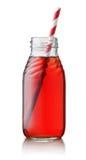 Juice bottle. Small juice bottle with straw isolated on white Stock Photo