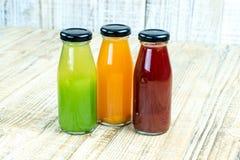 Juice bottle on wooden background Stock Photos