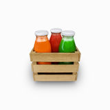 Juice bottles in a box on a white foneyu (carrot, tomato, spinach) Stock Photo