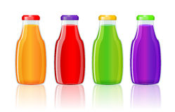 Juice bottles over white background Stock Images