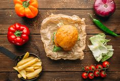Juice burger with steak on wooden table closeup Royalty Free Stock Photos