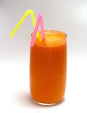 Juice carrot tubule. Fresh carrot Juice in glass with tubuls Royalty Free Stock Images