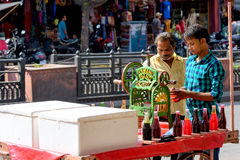 Juice cart in India, selling juice from colorful syrups Stock Photography