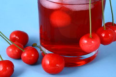 Juice cherry. Cherry-red fruits,red juice royalty free stock photography