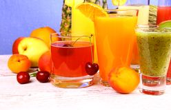Juice with cherry, apricot, kiwi, pineapple and pear Royalty Free Stock Image