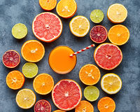 Juice with citrus fruit, grapefruit, orange on blue background. Top view, selective focus. Detox, dieting, clean eating royalty free stock photo