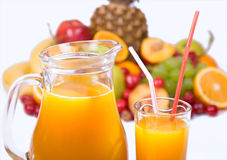 Juice and colorful fruits Royalty Free Stock Photography