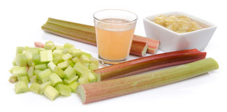 Juice and cooked rhubard with stalks and chopped rhubarb Stock Photography