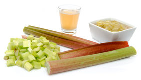 Juice and cooked rhubard with stalks and chopped rhubarb Stock Image