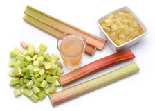 Juice and cooked rhubard with stalks and chopped rhubarb Royalty Free Stock Image
