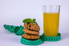 Juice and cookies and meter Stock Photos