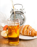 Juice, croissant and apple for a breakfast, Royalty Free Stock Images