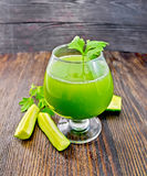 Juice cucumber with parsley in wineglass on board Royalty Free Stock Image