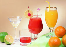 Juice drink. Glass with  orange juice & martini Stock Image