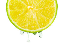 Juice drops on lime royalty free stock photos