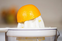 Juice extractor. Squeezing of orange juice on a juice extractor Royalty Free Stock Photos