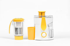 Juice extractor. Modern juice extractor on a white background Stock Image