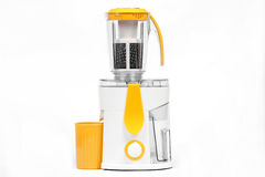 Juice extractor. Modern juice extractor on a white background Royalty Free Stock Photos