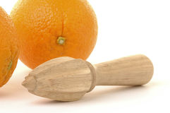 Juice Extractor. Wooden juice extractor and ripe oranges Royalty Free Stock Photo