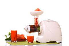 Juice extractor and carrot Royalty Free Stock Photography