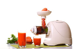 Juice extractor and carrot royalty free stock photo