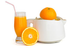 Juice extractor with a glass of orange juice Stock Photos