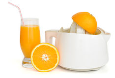 Juice extractor with a glass of orange juice. Isolated on white Royalty Free Stock Photo