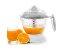 Juice extractor. With juice and ripe oranges Royalty Free Stock Image
